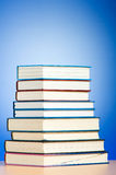 Stack of text books against gradient Stock Photo