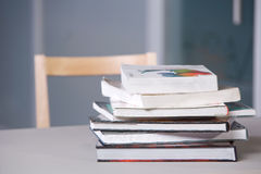 Stack of textbooks on a desk Stock Image