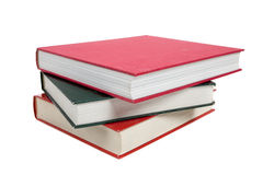 A stack of textbooks on white Royalty Free Stock Images