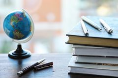 A stack of textbooks on the windowsill Royalty Free Stock Image