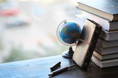 A stack of textbooks on the windowsill Royalty Free Stock Photo