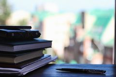 A stack of textbooks on the windowsill Stock Image