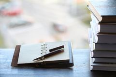 A stack of textbooks on the windowsill Royalty Free Stock Images