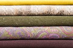Stack of textile rolls. Stack of colorful wool and felt textile rolls Stock Image