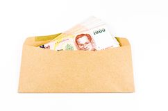 Stack of thai banknote on brown develope Stock Photo