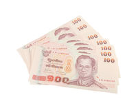 Stack of Thai one hundred type banknotes on white background Royalty Free Stock Images