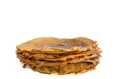 Stack of thin pancakes isolated on white background Royalty Free Stock Image