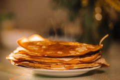 A stack of thin Russian hot pancakes blini  with steam emanating from them. Shrovetide Maslenitsa - traditional Russian holiday stock photos