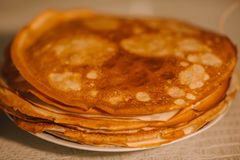 A stack of thin Russian hot pancakes blini  with steam emanating from them. royalty free stock images