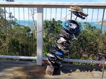 A stack of thongs used as a humorous decoration. On a balcony in sunny tropical Queensland Australia Stock Photography