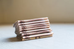 Stack of thousand bath Thai money on wooden table Stock Images