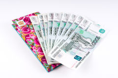 A stack of thousand-ruble banknotes, spread out and an envelope. Stock Images