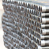 Stack of threaded pipes Stock Image