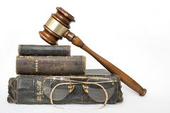 Three Antique Worn Leather Bibles with Gavel and Antique Glasses. Stack of three antique bibles with gavel and antique rimless glasses on white background Stock Photography