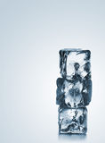 Stack of three blue ice cubes with copyspace Royalty Free Stock Images