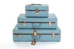 Stack of Vintage Suitcases. Stack of three blue vintage hard suitcases isolated on a white background Royalty Free Stock Photo