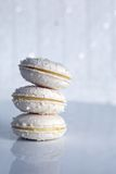 Stack of Three Coconut Macarons with Vanilla Cream Royalty Free Stock Photography