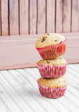 A stack of three cupcakes. On the white table royalty free stock photo