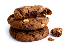 Stack of three dark chocolate chip cookies isolated. One broken Stock Photos