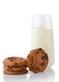 Stack of three homemade chocolate chip cookies, single cookie and glass of milk Royalty Free Stock Images