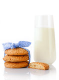 Stack of three homemade oatmeal cookies tied with blue ribbon in small white polka dots, half of cookie and glass of milk Stock Photos