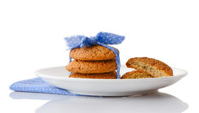 Stack of three homemade oatmeal cookies on white ceramic plate Royalty Free Stock Images
