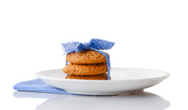Stack of three homemade oatmeal cookies on white ceramic plate Royalty Free Stock Image