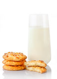 Stack of three homemade peanut butter cookies, halves of cookies and glass of milk Royalty Free Stock Photo