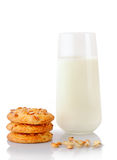 Stack of three homemade peanut butter cookies, peanuts, ear of oats and glass of milk Stock Photos