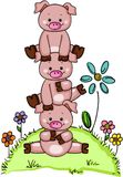 Stack of three little piggies in garden with flowers Stock Photos