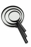 Stack of three magnifying glasses Royalty Free Stock Photos