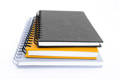 Stack of three notebooks or copybooks on white background Stock Photos