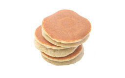 A stack of three plain pancakes on a white background. Stock Photos