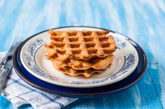 Plain Waffles on a Plate. A Stack of Three Plain Waffles on a Plate Stock Photo