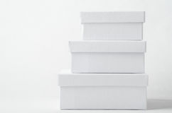 Stack of Three Plain White Boxes with Lids Royalty Free Stock Photography