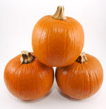Stack of three pumpkins. High resolution view of three pumpkins stacked isolated on a white background Royalty Free Stock Images