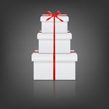 Stack of three realistic white gift boxes with red Royalty Free Stock Photos