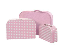 Stack of three suitcases, pink with white dots  Royalty Free Stock Photo