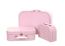 Stack of three suitcases, pink with white dots  Royalty Free Stock Photography