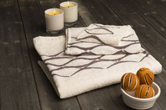 Stack of Three Towels with Brown Concave Line Design Royalty Free Stock Images