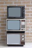 Stack of three TV sets. Vertical stack of three TV sets Royalty Free Stock Photography