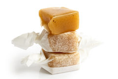 Stack of three wrapped vanilla caramel toffees . One unw Stock Photos