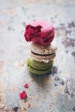 Stack of three yummy macaroons on rustic background Royalty Free Stock Photography