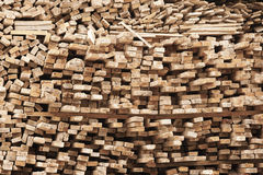 Stack of timber. Untidy stack of raw timber for construction Stock Photo