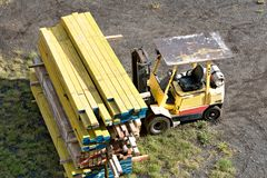 Stack of Timber and a Forklift Stock Photos