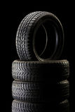 Stack of tires in dark ambient on black background Royalty Free Stock Image