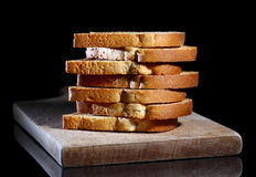 Stack of toasts. Close up of toasted white bread in slices on cutting board over black background Stock Images