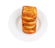 Stack of toasts on white plate Royalty Free Stock Images