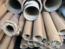 Stack together of old paper core. Pile of brown paper tubes royalty free stock photography