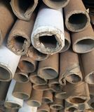 Stack together of old paper core. Pile of brown paper tubes stock photo